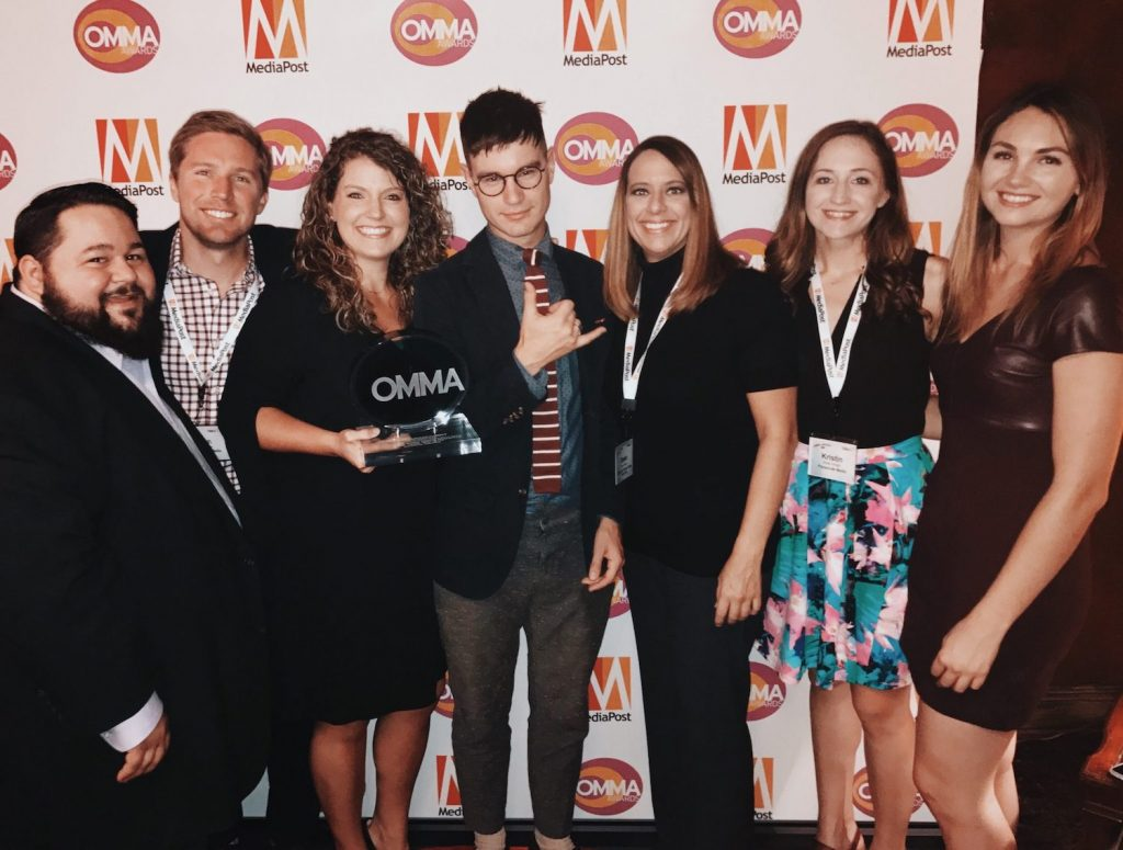 The Parachute Media team posing for a picture, holding their OMMA awards.