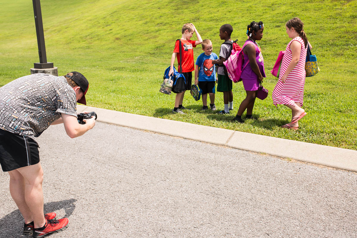 Videographer James filming our talent for the School Bus PSA.