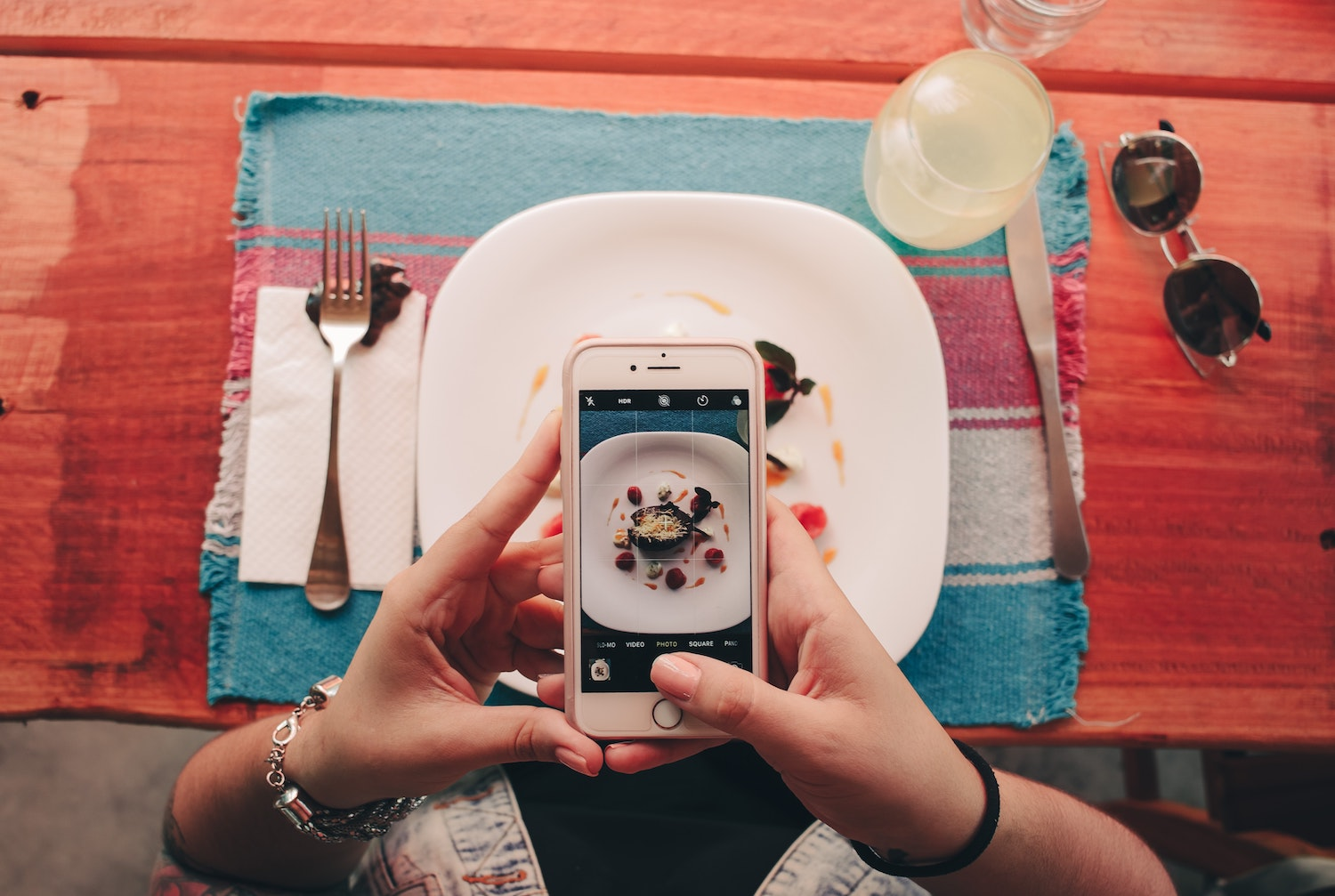 A photo of someone taking a photo of their food with their phone.