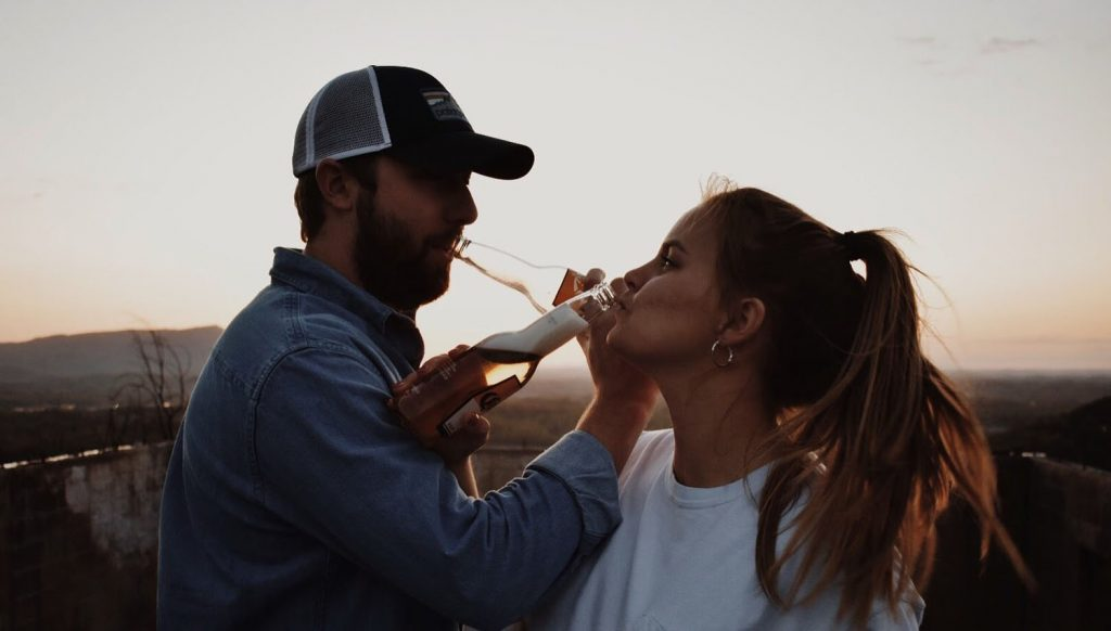 Lauren Henley drinking beer with her fiance