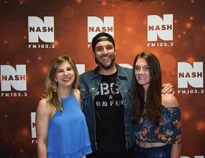 Two fans with Tyler Rich at CMA Fest