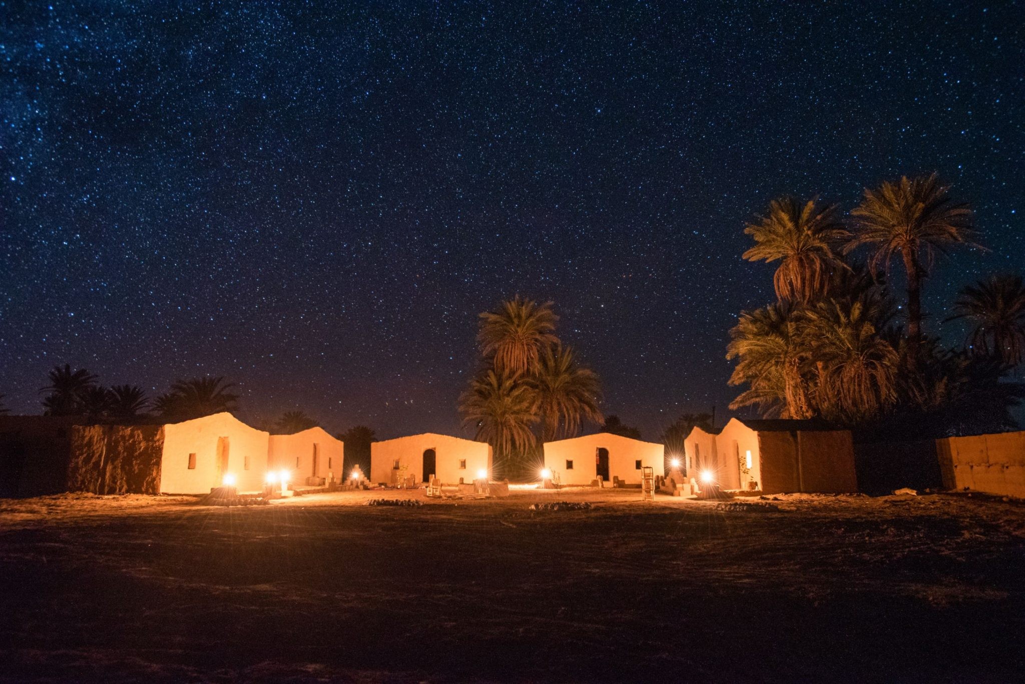 An image of a small village of houses in the Morocco Sahara Desert.